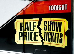 a half price show tickets advertisement billboard