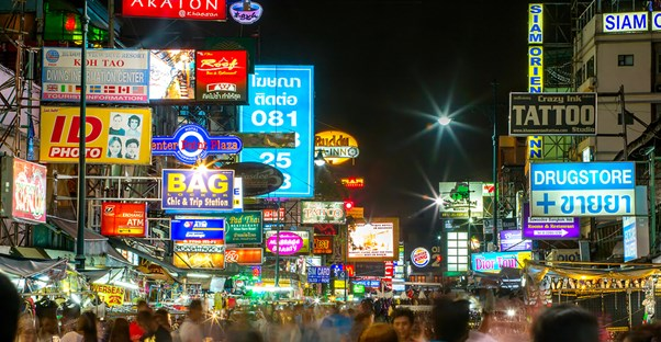 downtown Bangkok is lit up by lights and bright signs